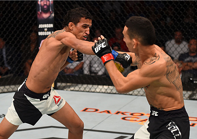 Charles Oliveira and Max Holloway